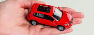 image of a red car in person's palm